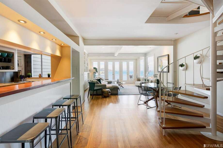 The main level of the home has a open entertaining space that leads out to the view deck. Photo: Circle Visions