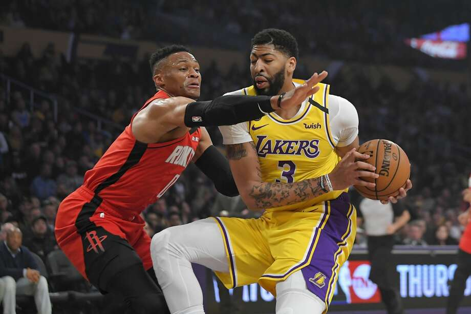 Houston Rockets guard Russell Westbrook, left, reaches for the ball held by Los Angeles Lakers forward Anthony Davis during the first half of an NBA basketball game Thursday, Feb. 6, 2020, in Los Angeles. (AP Photo/Mark J. Terrill) Photo: Mark J. Terrill/Associated Press
