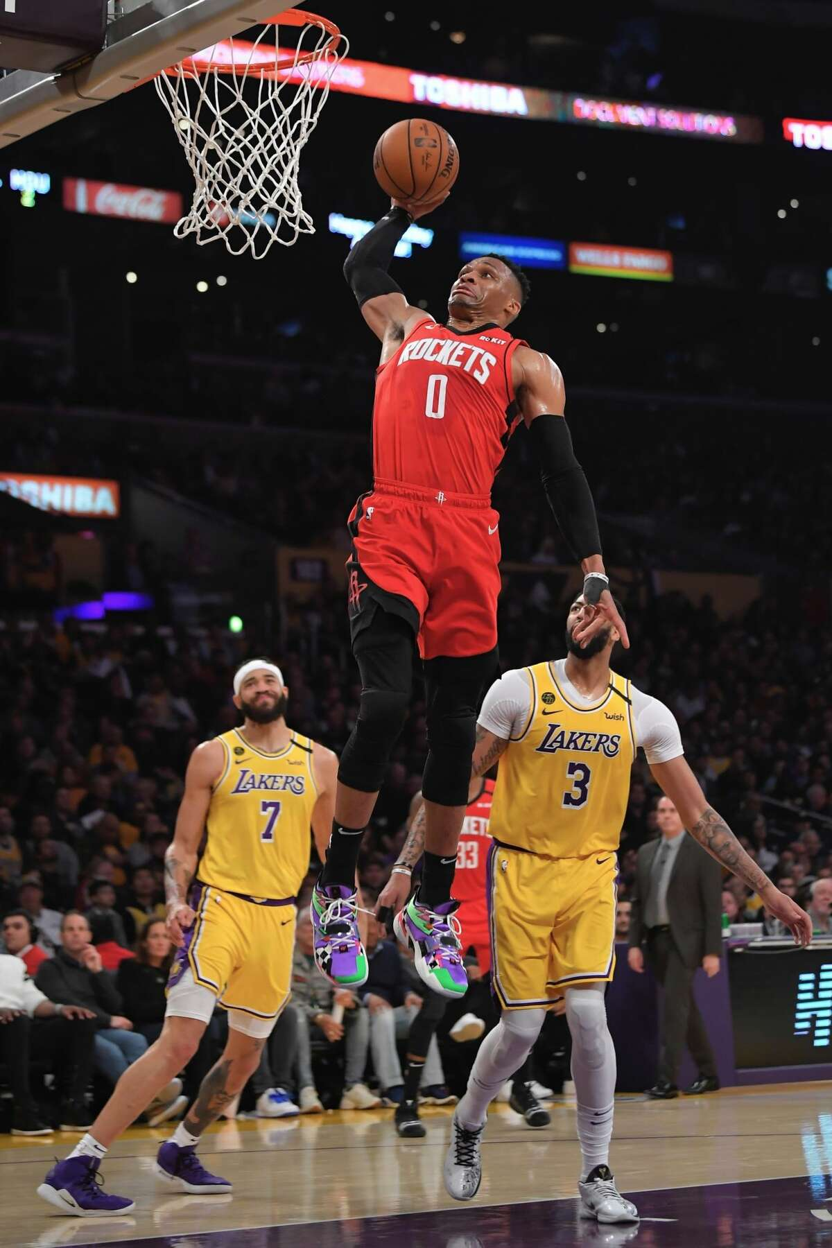 Houston Rockets guard Russell Westbrook dunks as Los Angeles Lakers center JaVale McGee, left, and forward Anthony Davis watch during the second half of an NBA basketball game Thursday, Feb. 6, 2020, in Los Angeles. (AP Photo/Mark J. Terrill)
