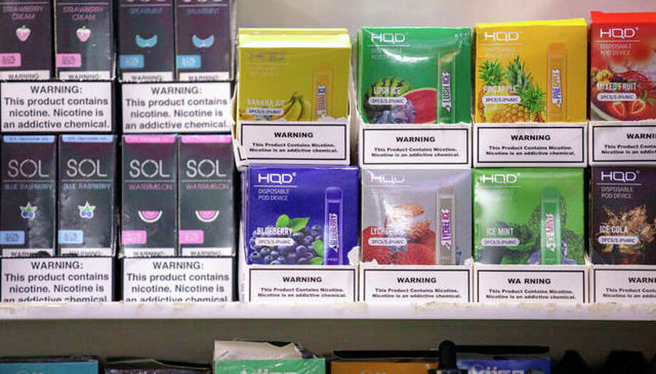 Various brands and flavors of disposable vape devices sit on a shelf at a store. The U.S. government began enforcing restrictions on flavored electronic cigarettes aimed at curbing underage vaping. But parents, researchers and students warn that some young people already have moved on to a newer kind of vape that isn't covered by the flavor ban — disposables. Photo: Marshall Ritzel   AP