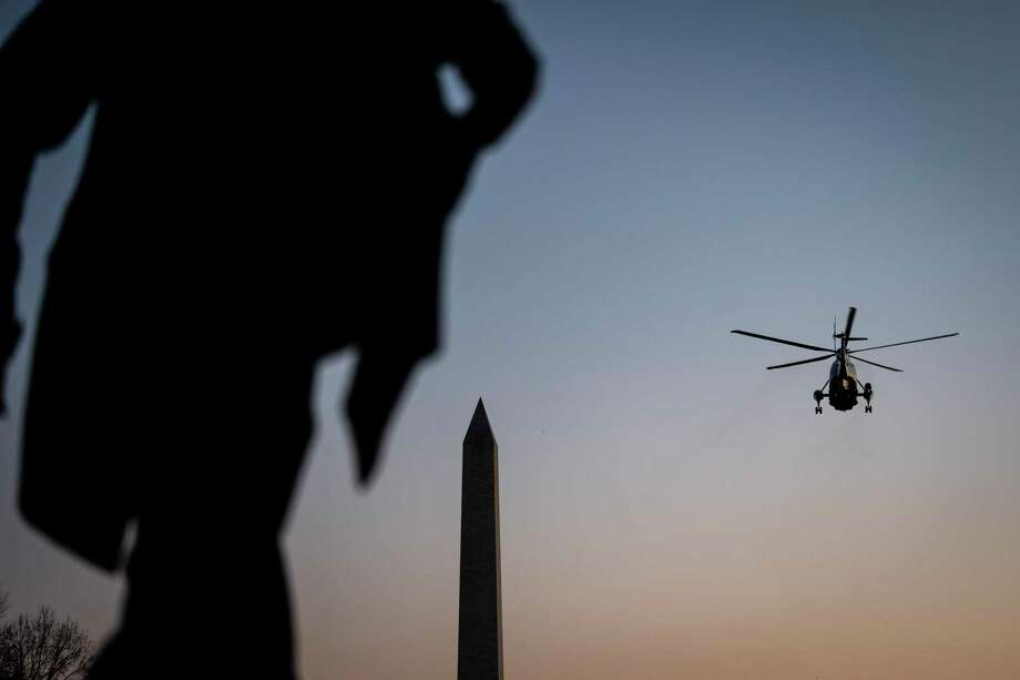 Marine One lifts lifts off from the South Lawn as President Donald Trump departs from the White House on Dec. 18, 2019. Photo: Washington Post Photo By Jabin Botsford / The Washington Post