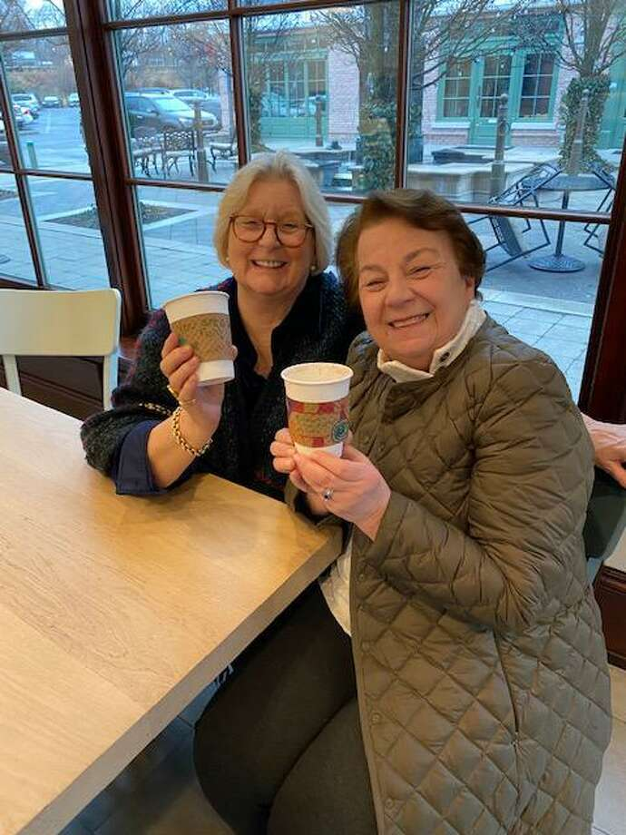 Kitty Fowler, left, and Lucille Dunkin, grandmother of Royle students Caroline and Emma Donnelly, enjoyed the NEAT beverages with a special kindesss sleeve this week courtesy Royle School students. Photo: Contributed /