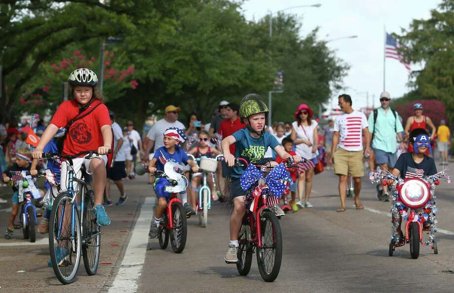 Children decorated their bicycles with patriotic colors and led the 4th of July parade Tuesday, July 4, 2017, in Bellaire, Texas. ( Godofredo A. Vasquez / Houston Chronicle ) Photo: Godofredo A. Vasquez, Staff / Houston Chronicle / Godofredo A. Vasquez