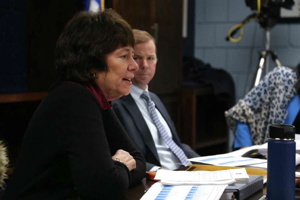 Superintendent of Schools Kevin Smith listens to Board of Education Chair Deborah Low share a comment at a meeting on Feb. 6.