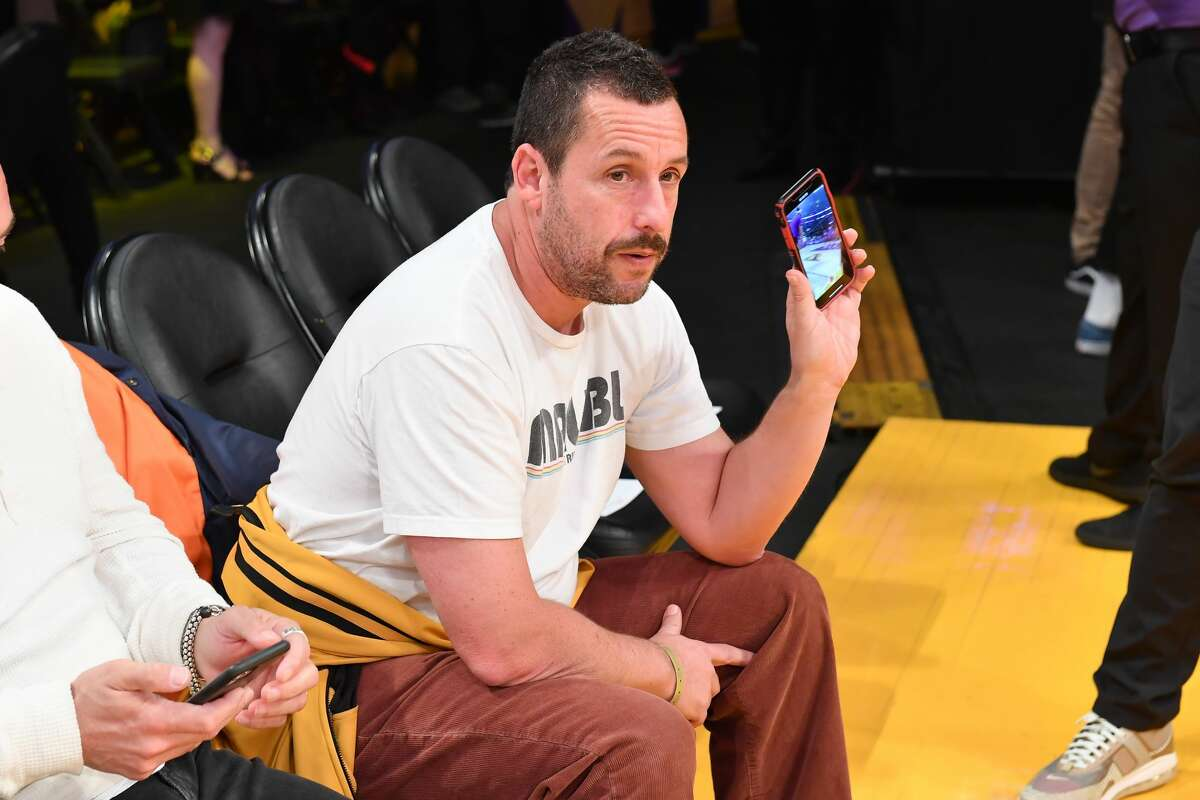 LOS ANGELES, CALIFORNIA - FEBRUARY 06: Adam Sandler attends a basketball game between the Los Angeles Lakers and the Houston Rockets at Staples Center on February 06, 2020 in Los Angeles, California. (Photo by Allen Berezovsky/Getty Images)