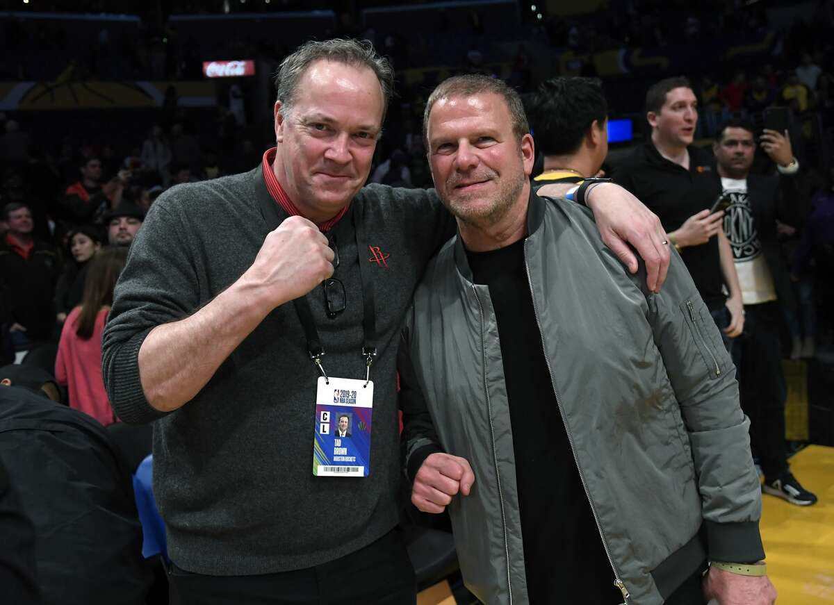 Tad Brown (L), Chief Executive Officer of the Houston Rockets, and Tilman Fertitta, owner of the Houston Rockets and chairman, Chief Executive Officer and sole owner of Landry's, Inc., one of the largest restaurant corporations, celebrate the Rockets win over Los Angeles Lakers at Staples Center on February 6, 2020 in Los Angeles, California.
