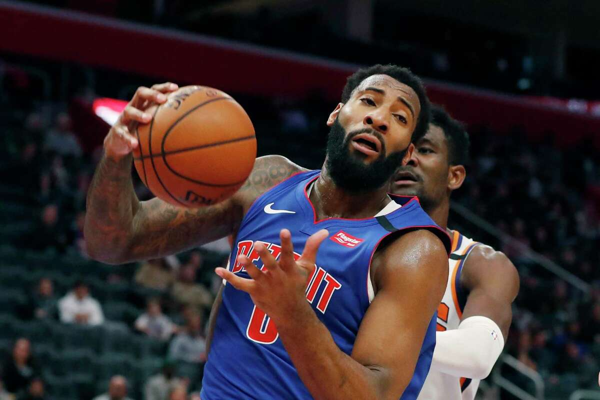 Detroit Pistons center Andre Drummond pulls down a rebound during the second half of an NBA basketball game against the Phoenix Suns, Wednesday, Feb. 5, 2020, in Detroit.