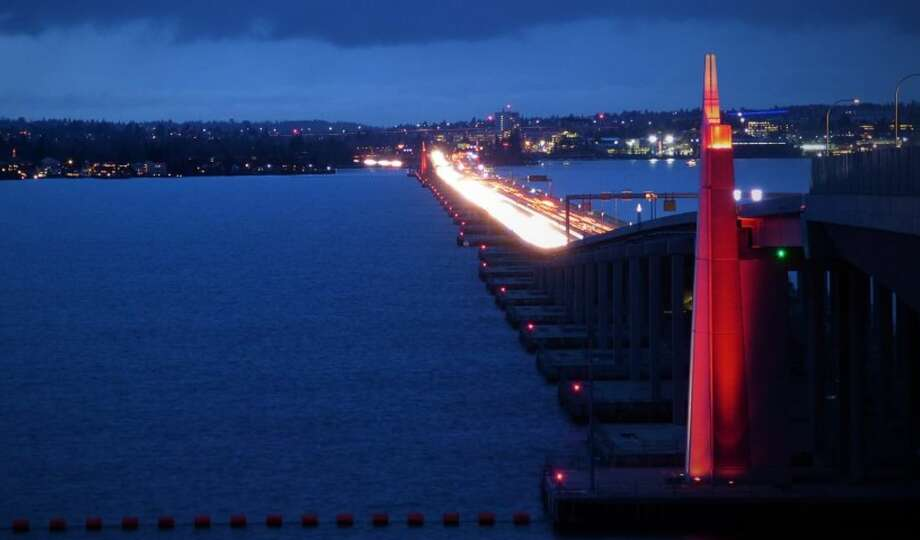 The state Route 520 bridge lit up in red on Thursday night for Wear Red Day. Photo: Courtesy Washington State Department Of Transportation