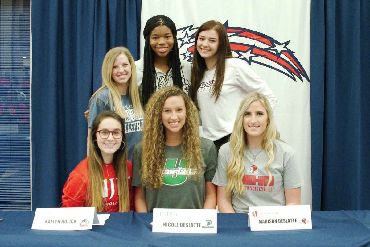 Dawson volleyball players signing national letters of intent are (front row, left to right) Kaelyn Hulick, New Jersey Institute of Technology, Nicole Deslatte, University of South Carolina Upstate; Madison Deslatte, Gardner-Webb University; (back row) McKinley Sellers, St. Edward's University; Aliyah McDonald, Oregon State University; and Lauren Scott, St. Edward's University.