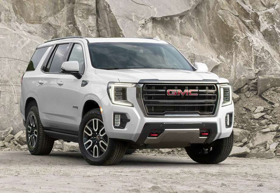 The 2021 GMC Yukon AT4's optional four-corner air ride suspension can provide an additional 2 inches of ground clearance when driving off road. The AT4 is expected to land at dealers late this summer. Photo: GMC / CGIBackgrounds, Inc.