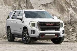 The 2021 GMC Yukon AT4's optional four-corner air ride suspension can provide an additional 2 inches of ground clearance when driving off road. The AT4 is expected to land at dealers late this summer.