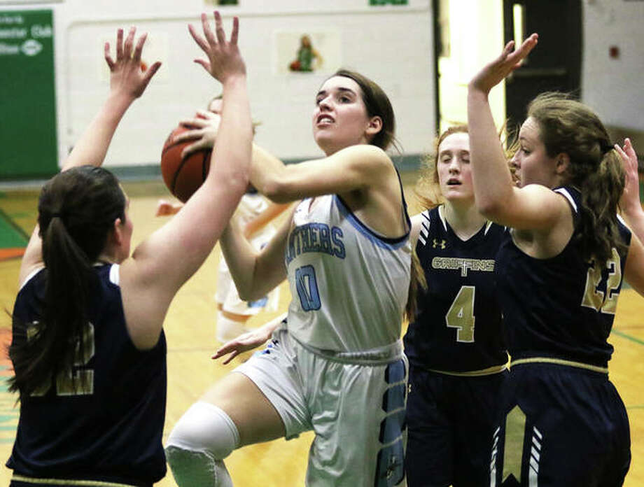 Jersey's Abby Manns (middle) puts up a shot in traffic against Father McGivney during a Carrollton Tournament semifinal on Jan. 30. On Thursday night in Jerseyville, Manns scored 17 points and became the 14th player in Panthers' history to score 1,000 career points in a win over Highland. Photo: Greg Shashack / The Telegraph