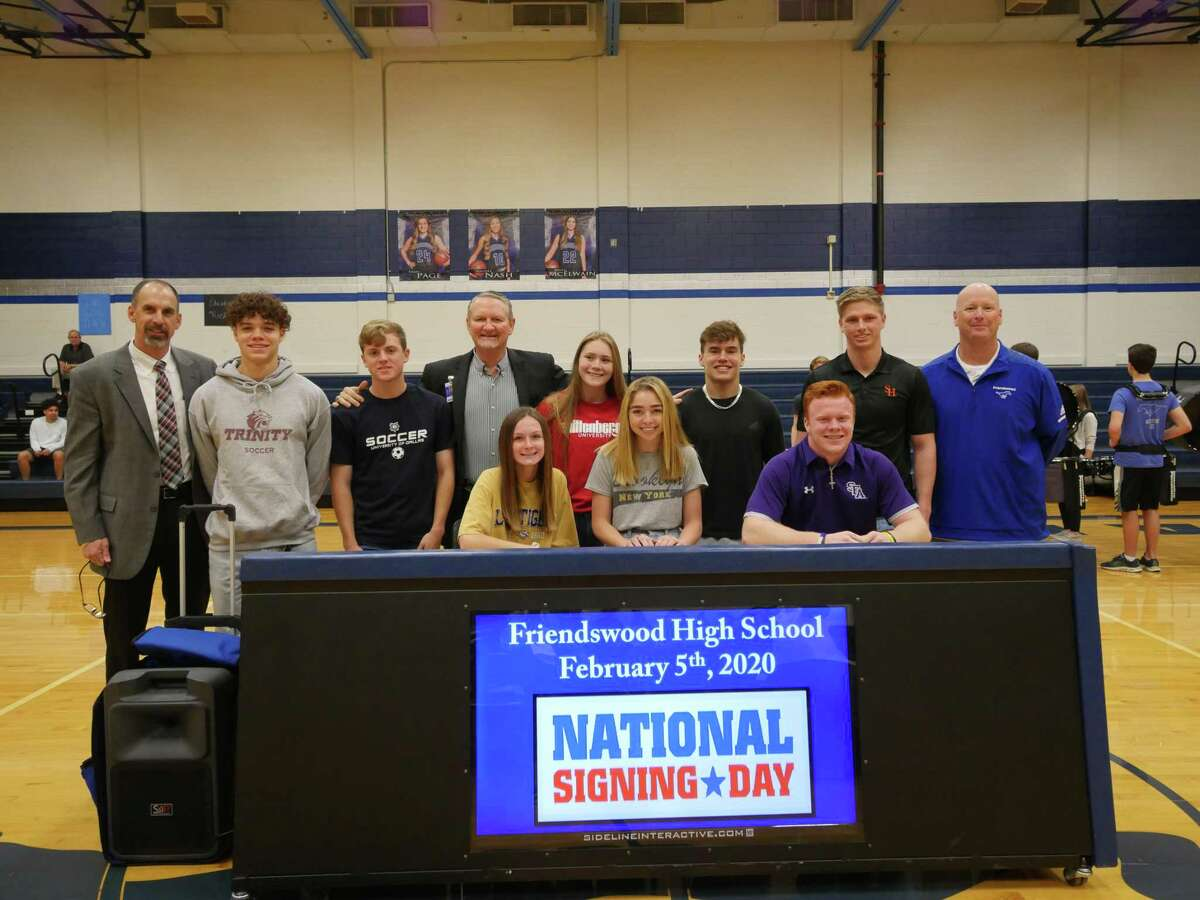 Friendswood athletes signing national letters of intent are pictured with FISD administrators. Back row, left to right, are FISD Superintendent Thad Roher, Michael Black, Trinity University (soccer); Braden DeCuir, University of Dallas (soccer); FHS Principal Mark Griffon, Elizabeth Schexnaider, Wittenberg University (water polo); Connor Haines, Texas Lutheran University (football) Trey Mappe, Sam Houston State (football); FHS Athletic Director Robert Koopmann; (front row) Catherine Sims, Louisiana State University (cross country/track) Heidi Demel, St. Francis College (golf); Ryan Helton, Stephen F. Austin University (football).
