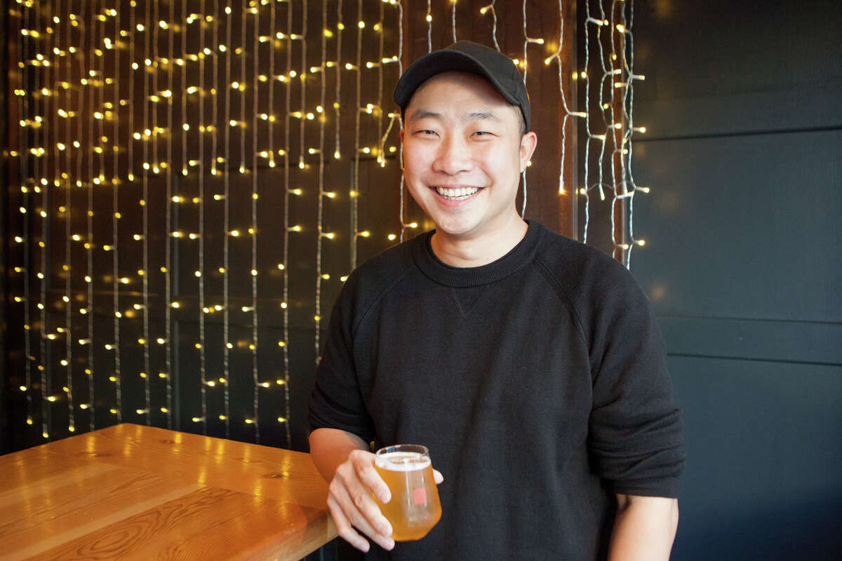 Youngwon Lee, founder of Dokkaebier, stands in his pop-up taproom and restaurant in San Francisco on February 6, 2020. The pop-up opens this month.