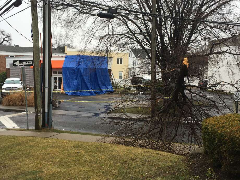 A large blue tarp covers the damage at Chocoylatte Gourmet on Friday morning after the shop was hit by a car late Thursday night. Photo: / Robert Marchant / Hearst Media