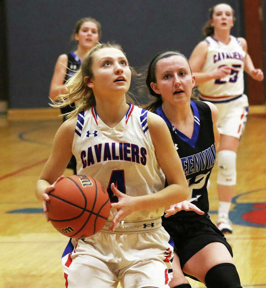 Carlinville's Jill Stayton beats Greenville to the basket during the first half of a South Central Conference girls basketball game in Carlinville. The Cavaliers beat the Comets 34-30 to force a four-way tie for the SCC championship with Carlinville, Greenville, Hillsboro and Pana all finishing 7-2. Photo: Greg Shashack / The Telegraph