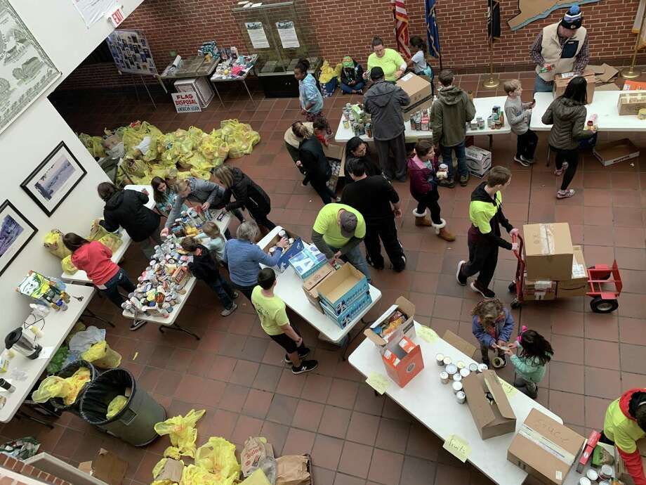 In November, Cromwell BSA Troop 26 hosted its annual Scouting for Food Drive with the help from Cub Scout Pack 36 and several Girl Scout Troops. Photo: Contributed Photo