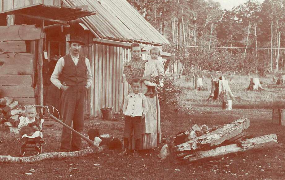 Richard and Cora Ely and first living quarters on their homestead on Ely Rd., c. 1895, where stumps are yet to be cleared. Children are Walter, Vesta, and Andrew. (Courtesy Photo)