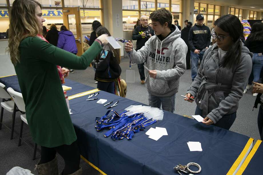 Wayland admissions representative Cindy Horn (left) help students register for the third annual Languages and Culture festival at Wayland Baptist University on Tuesday. Approximately 100 area high school students competed in academic events. Photo: Courtesy Photo/WBU