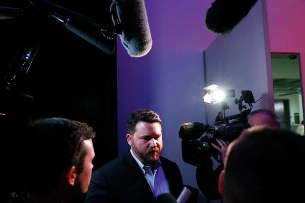 Iowa Democratic Party chairman Troy Price speaks to reporters about the delay in Iowa caucus results, Tuesday, Feb. 4, 2020, in Des Moines, Iowa.