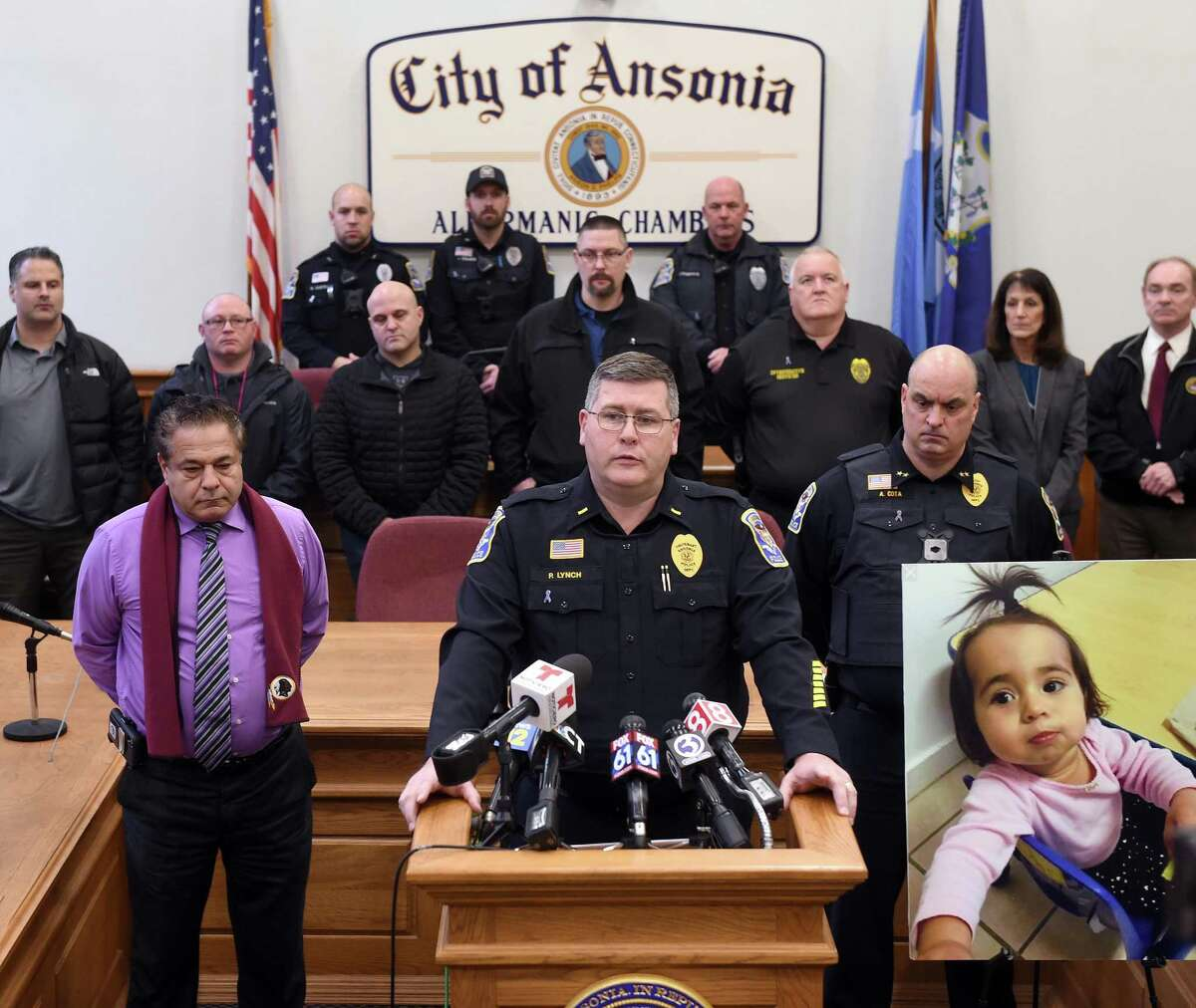 Ansonia Police Department Lt. Patrick Lynch speaks at a news conference at Ansonia City Hall on Friday announcing charges of murder and tampering with evidence against Jose Morales related to the homicide of Christine Holloway. At right is a photograph of Holloway's missing 1-year-old daughter, Vanessa Morales.