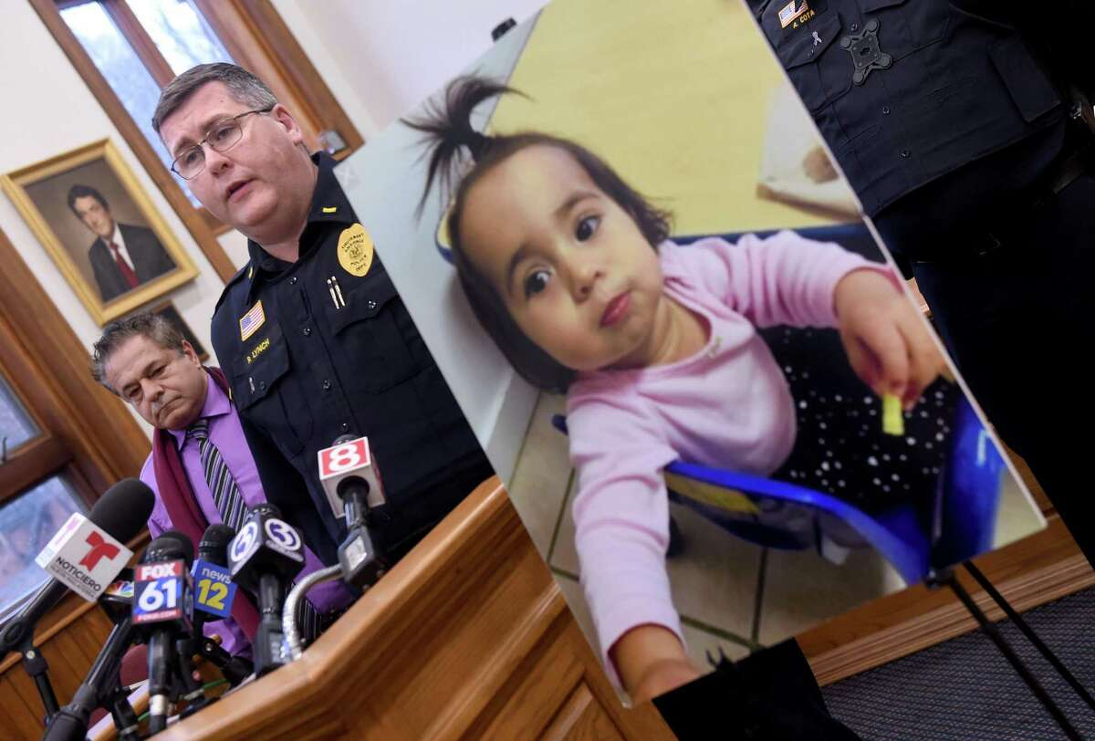 Ansonia Police Lt. Patrick Lynch speaks at a news conference at Ansonia City Hall on Friday. At right is a photograph of missing 1-year-old Vanessa Morales.