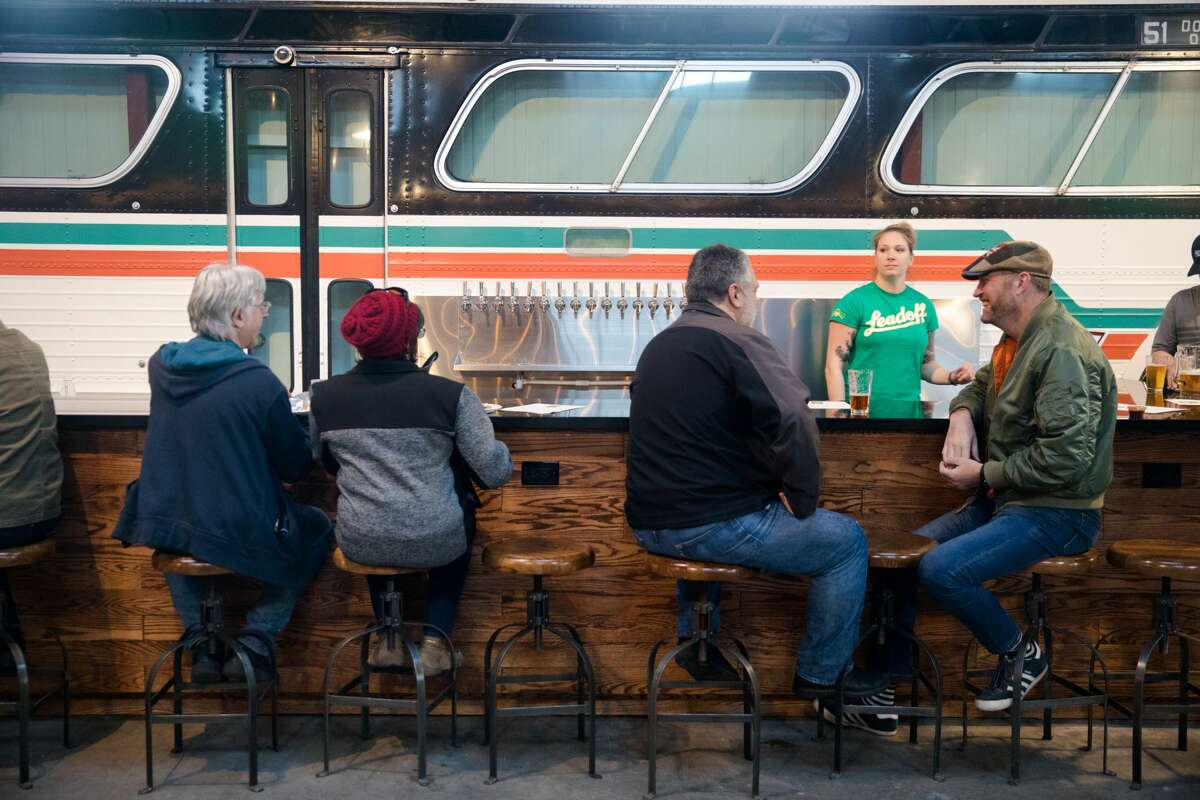 Patrons sit at the bar of the Line 51 Brewery and Tasting Room, The Terminal, near Jack London Square, during its soft opening in Oakland, Calif., on Feb. 6, 2020.