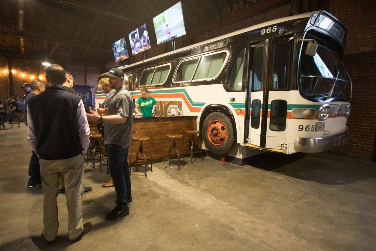 An authentic AC Transit bus is the most prominent feature of the Line 51 Brewery and Tasting Room, The Terminal, near Jack London Square, during their soft opening in Oakland, Calif., on Feb. 6, 2020.