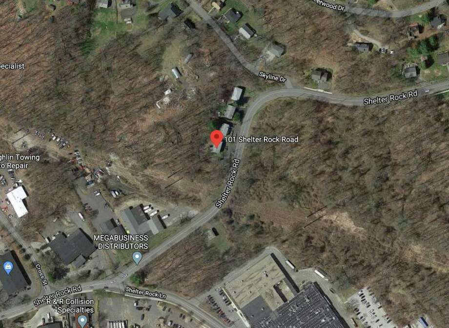 A downed tree and wires were reported in the area of 101 Shelter Rock Road in Danbury Friday afternoon. Photo: Google Maps / Google
