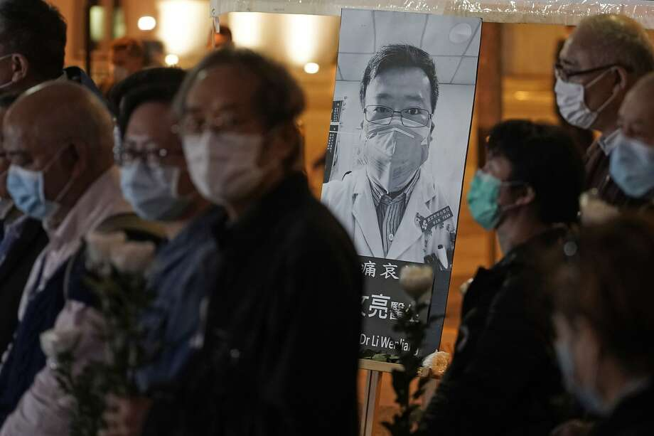 Protesters in Hong Kong attend a vigil for Chinese Dr. Li Wenliang, who tried to warn of virus dangers. Photo: Kin Cheung / Associated Press