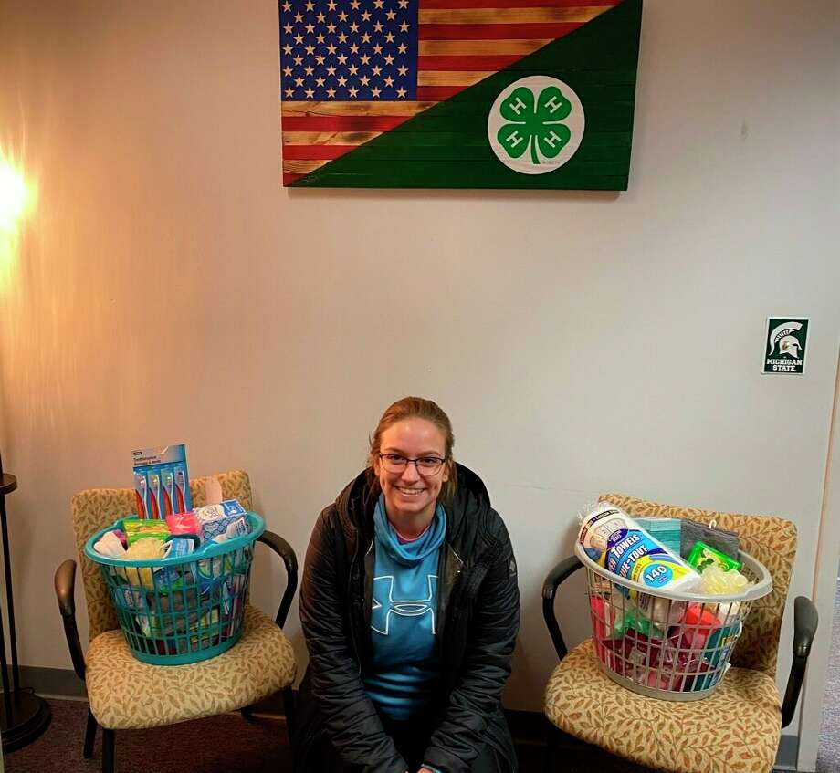 Jr. Livestock 4-H President Lauren Marfio poses with some of the first donations to be brought in for the Mecosta County 4-H Community Service project. According to 4-H Program Coordinator Mollie Hogg, the February project will be donating items to Sisters of Sobriety, a recovery home in Remus for women recovering from substance abuse. (Courtesy photo)