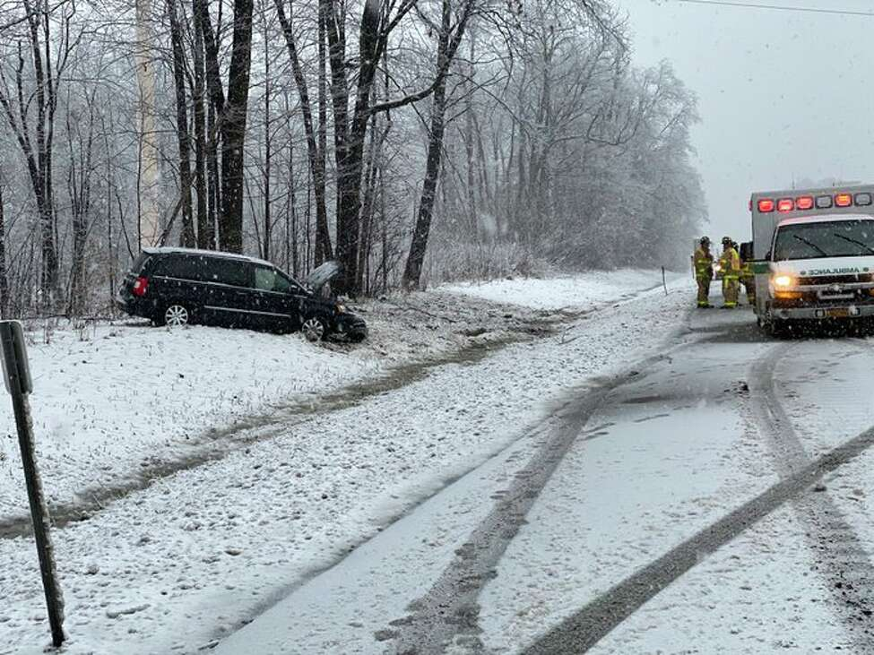 Emergency crews work at a crash scene on the southbound side of the Northway near Exit 12 in Malta. The crash occurred as the region was gripped by a combination of ice and snow on Friday, Feb. 7, 2020.
