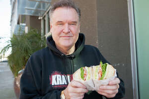 Frank Sommerville shows us his favorite deli in Oakland on Thursday, February 6, 2020. A vegetarian since age 12, his regular order is a veggie sandwich with lettuce, tomato, onion, avocado, Swiss cheese and dijon mustard on a hard French roll.