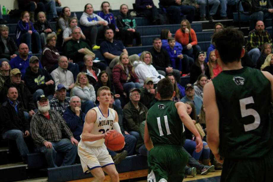 Morley Stanwood's Aiden McLaughlin (left) is in his fourth varsity basketball season. (Pioneer photo/John Raffel)