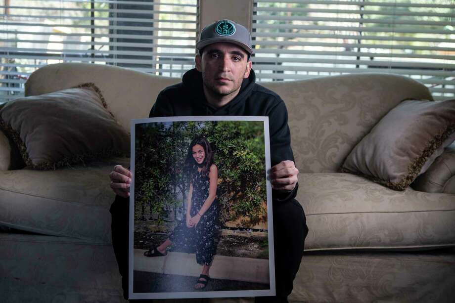 Hector Bribiescas poses with a photo of his daughter, London Bribiescas, at his family's home in the San Antonio area. London, a fifth grader at Leon Springs Elementary School, was found shot to death with her mother, Nichol Olsen, and sister, Alexa Montez, on Jan. 10, 2019 at a luxury home near Leon Springs. The families have been waiting more than a year for answers in the case. Photo: Josie Norris /Staff Photographer / **MANDATORY CREDIT FOR PHOTOG AND SAN ANTONIO EXPRESS-NEWS/NO SALES/MAGS OUT/TV