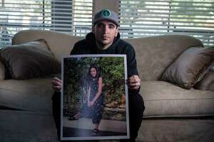 Hector Bribiescas poses with a photo of his daughter, London Bribiescas, at his family's home in the San Antonio area. London, a fifth grader at Leon Springs Elementary School, was found shot to death with her mother, Nichol Olsen, and sister, Alexa Montez, on Jan. 10, 2019 at a luxury home near Leon Springs. The families have been waiting more than a year for answers in the case.
