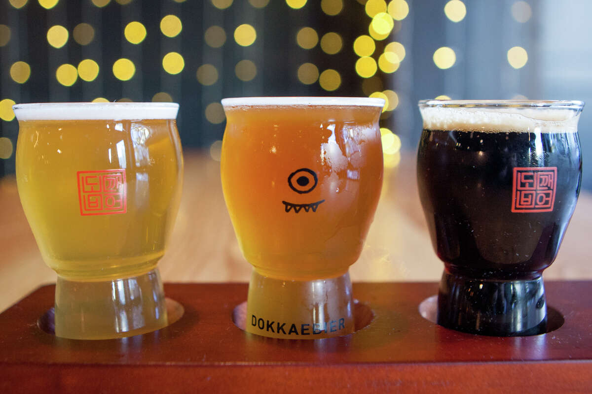 A flight of three Dokkaebier beers, including (L-R) a pilsner made with bamboo, a witbier brewed with omija berry and gochugaru chili, and a stout made with cardamom and green peppercorn.