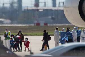 People at risk of carrying the coronavirus arrive at Joint Base San Antonio-Lackland earlier this month. Some have questioned why evacuees should come here, and the simplest answer is because it's the right thing to do.
