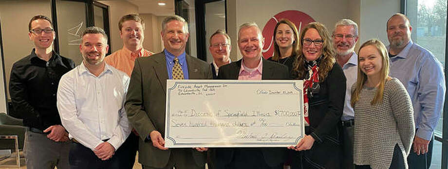 """Fireside Financial officials gave $700,000 to the Archdiocese of Springfield for a variety of """"good works."""" Photo: Courtesy Of Fireside Financial"""