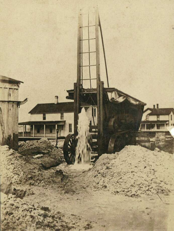 This photograph from the 1920s shows one of the artesian wells that were located in Onekama.