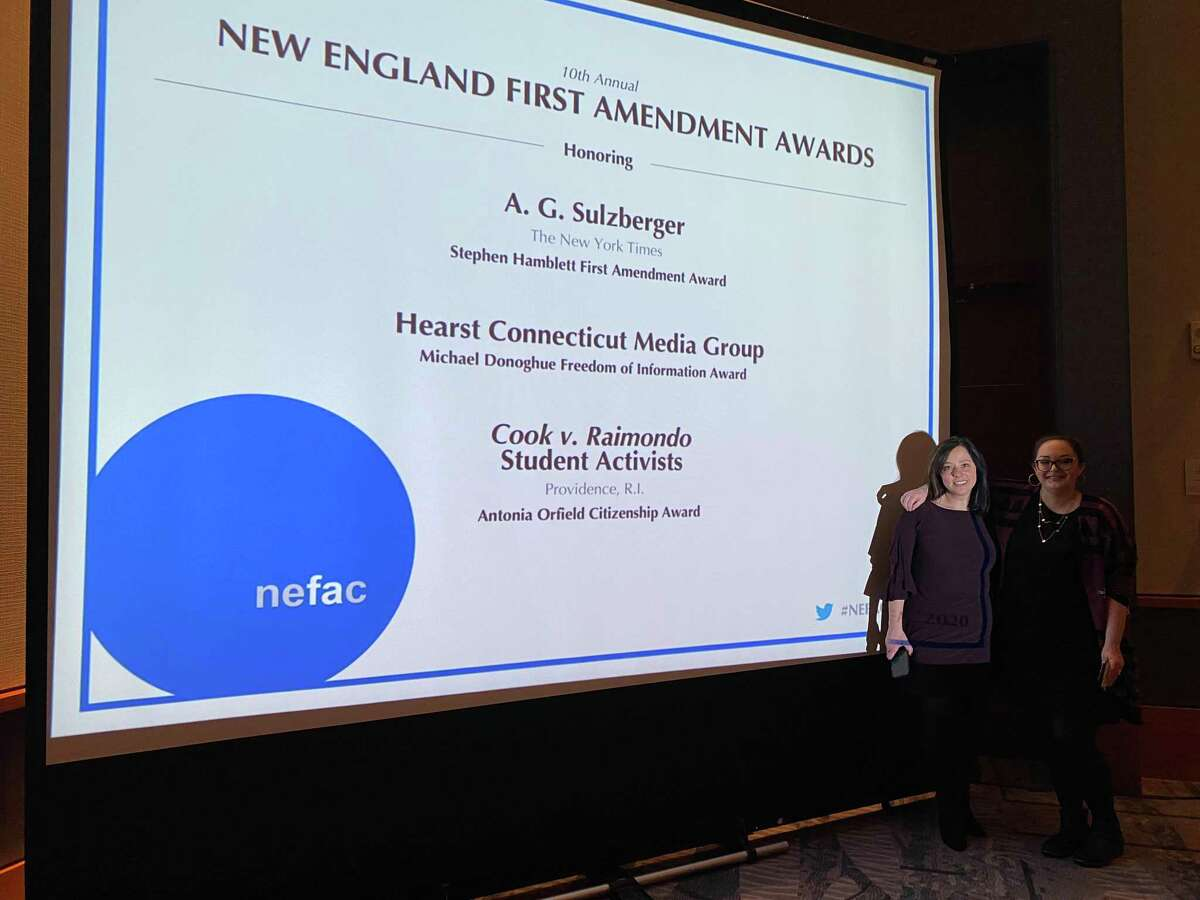 Editor Lisa Yanick Litwiller and reporter Hannah Dellinger prepare to accept the Michael Donoghue Freedom of Information Award from the New England First Amendment Coalition for their work on Hearst Connecticut Media's investigation into abuse cases connected to Boys and Girls Clubs across the country.