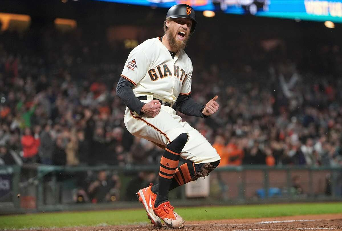 FILE - Hunter Pence #8 of the San Francisco Giants reacts after he scored against the San Diego Padres in the bottom of the seventh inning at AT&T Park on September 25, 2018 in San Francisco, California.