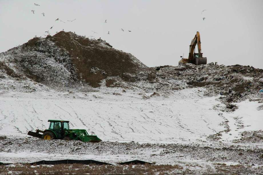 Work moving around refuse goes on at the Huron County Landfill. Emterra USA, the landfill's owner, plans on expanding it over the course of this year. (Robert Creenan/Huron Daily Tribune)