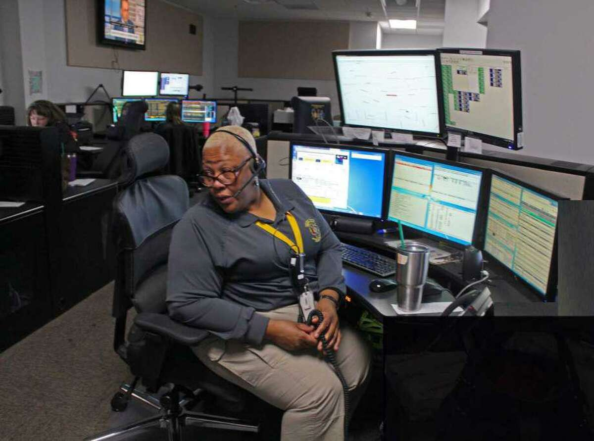 A worker answers calls at the Fort Bend County Dispatch Center.