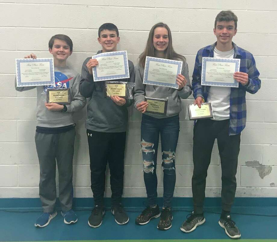 The Manisteee Middle School team of (left to right) Jack O'Donnell, Jacob Sharp, Ceci Postma and Luke Smith took first place overall in the MathCounts competition at West Shore Community College. (Courtesy photo)