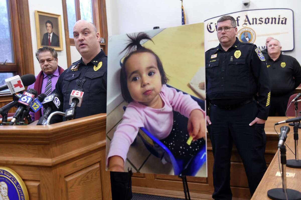 Ansonia Police Chief Andrew Cota, III, (left) speaks at a press conference at Ansonia City Hall on February 7, 2020 announcing charges or murder and tampering with evidence for Jose Morales related to the homicide of Christine Holloway. At right is a photograph of Halloway's missing 1-year-old daughter, Vanessa Morales.