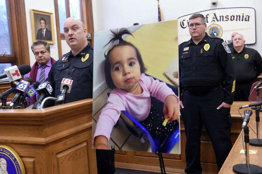 Ansonia Police Chief Andrew Cota, III, (left) speaks at a press conference at Ansonia City Hall on February 7, 2020 announcing charges or murder and tampering with evidence for Jose Morales related to the homicide of Christine Holloway. At right is a photograph of Halloway's missing 1-year-old daughter, Vanessa Morales. Photo: Arnold Gold / Hearst Connecticut Media / New Haven Register