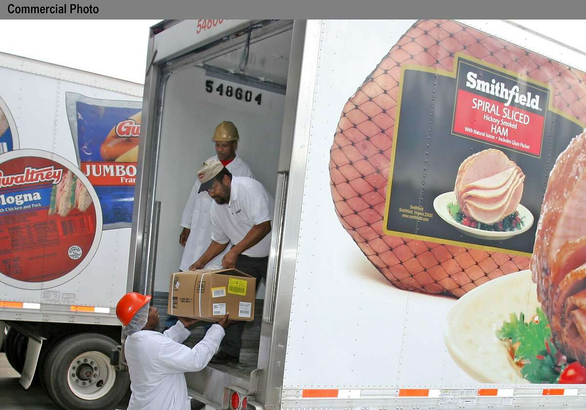 Smithfield Packing Company employees in Smithfield, Va., load two trucks with 65,000 pounds of lunchmeat that will help feed Hurricane Katrina victims in Louisiana and Mississippi. Two employees-Nathaniel Johnson and John Humphrey-volunteered to drive the trucks because both are from Mississippi and have family members living in the area devastated by the hurricane. (PRNewsFoto)