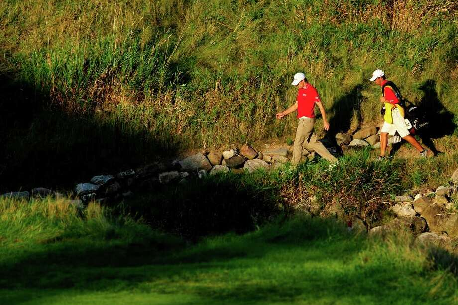 KOHLER, WI - AUGUST 14:  Nick Watney and caddie Chad Reynolds walk on the 18th hole during the third round of the 92nd PGA Championship on the Straits Course at Whistling Straits on August 14, 2010 in Kohler, Wisconsin.  (Photo by Stuart Franklin/Getty Images) *** Local Caption *** Nick Watney;Chad Reynolds Photo: Stuart Franklin, Getty Images / 2010 Getty Images