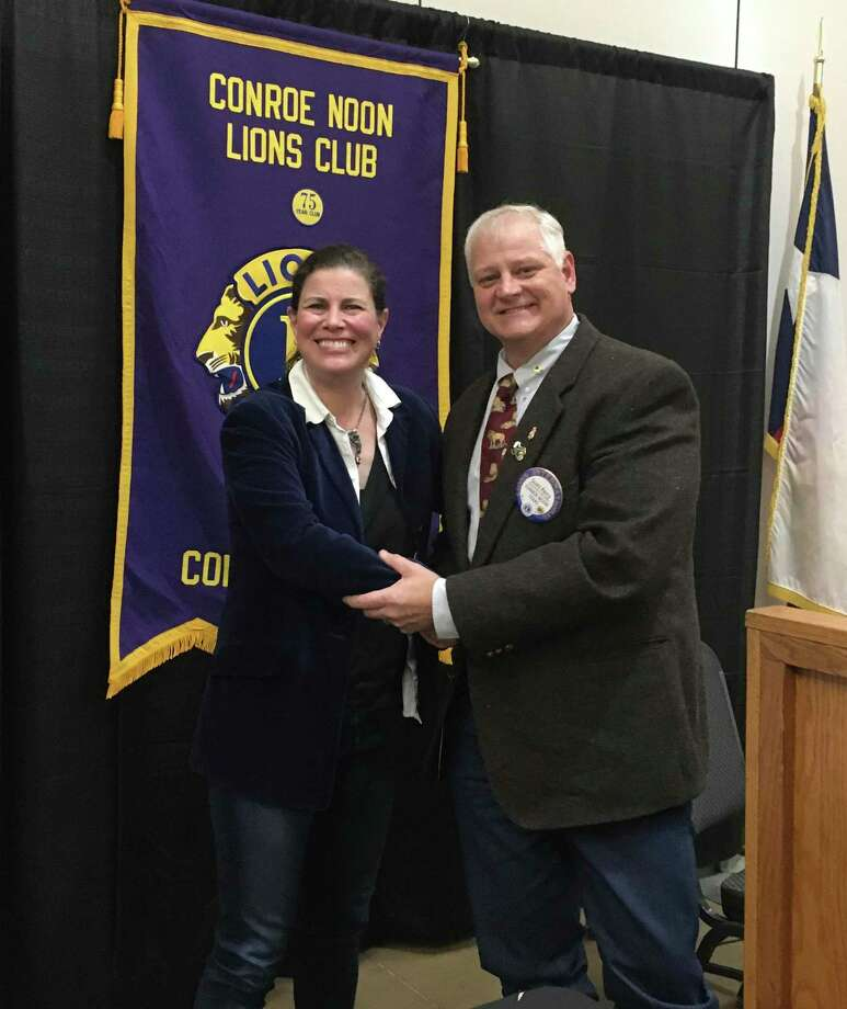 The Conroe Noon Lions Club President Scott Perry, right, thanks sportswriter Stephanie Stradley, left, for her talk at the club meeting last week by presenting her a club pen, to help continue her writings of the Houston Texans. Photo: Courtesy Photo